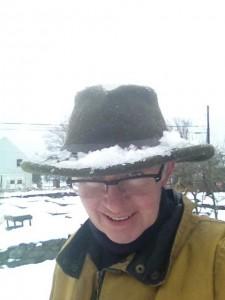 snow on hat
